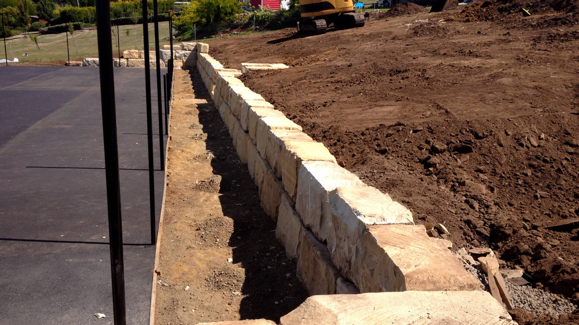 Sandstone wall before landscaping