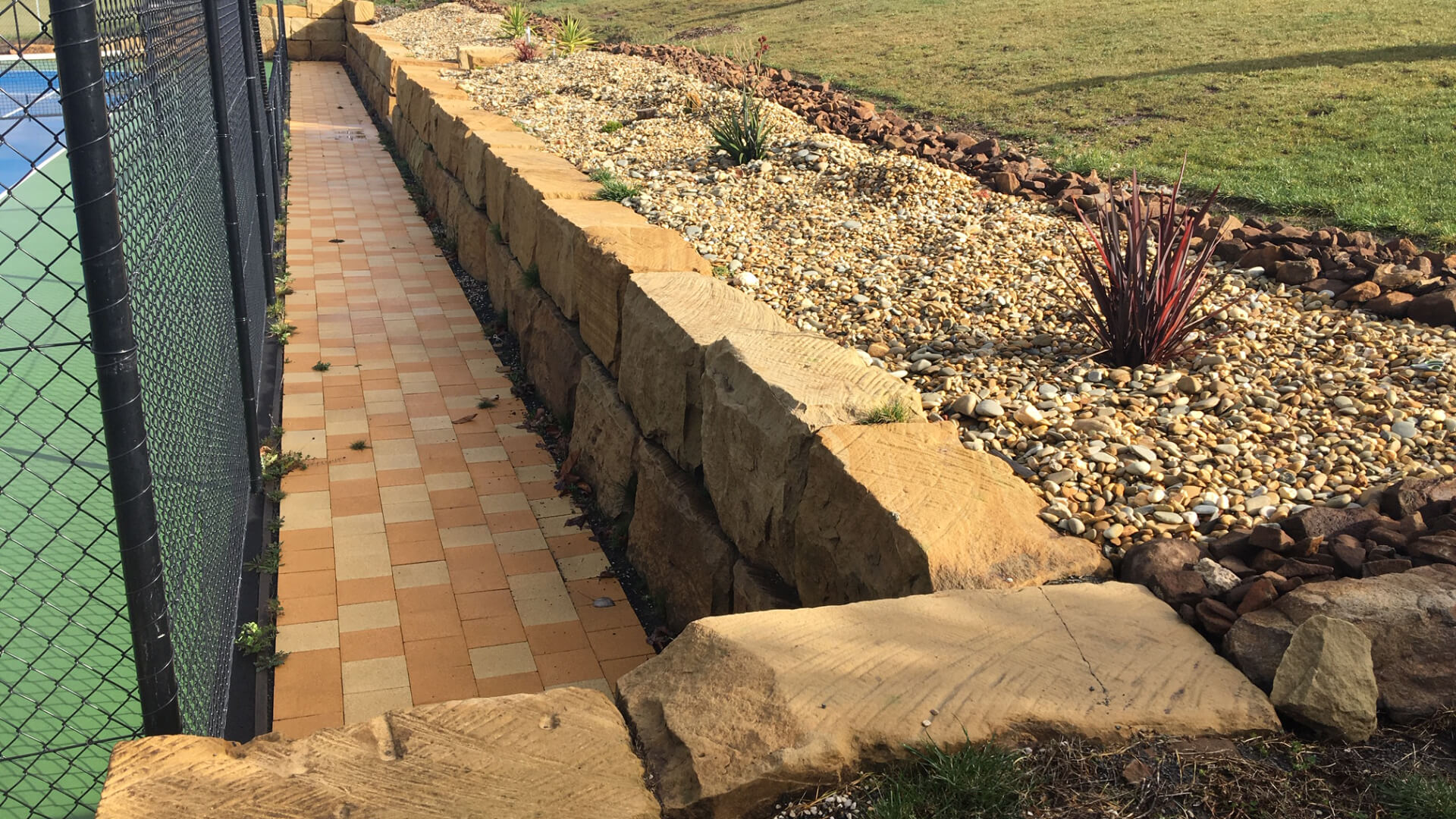 Sandstone wall after landscaping